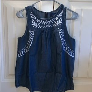 tank top with white embroidery design